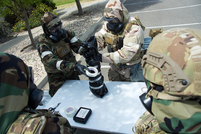 Airmen 1st Class Justin Coleman, Ryan Countryman, and Bobby Potts, and Staff Sgt Richard Halter, 60th Civil Engineer Squadron explosive ordnance technicians, participate in a training scenario at Travis Air Force Base, Calif., on April 17, 2017. EOD techs conduct training on various threats to ensure they are prepared for deployment. (U.S.Air Force photo/Staff Sgt. Daniel Phelps)