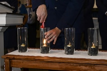 U.S. Air Force Col. Scott Campbell, 355th Fighter Wing commander, lights a candle during a Holocaust remembrance ceremony at Davis-Monthan Air Force Base, Ariz., April 24, 2017. The ceremony was held to honor the 6 million Jews and millions of others that lost their lives during the Holocaust. (U.S. Air Force photo by Airman 1st Class Giovanni Sims)
