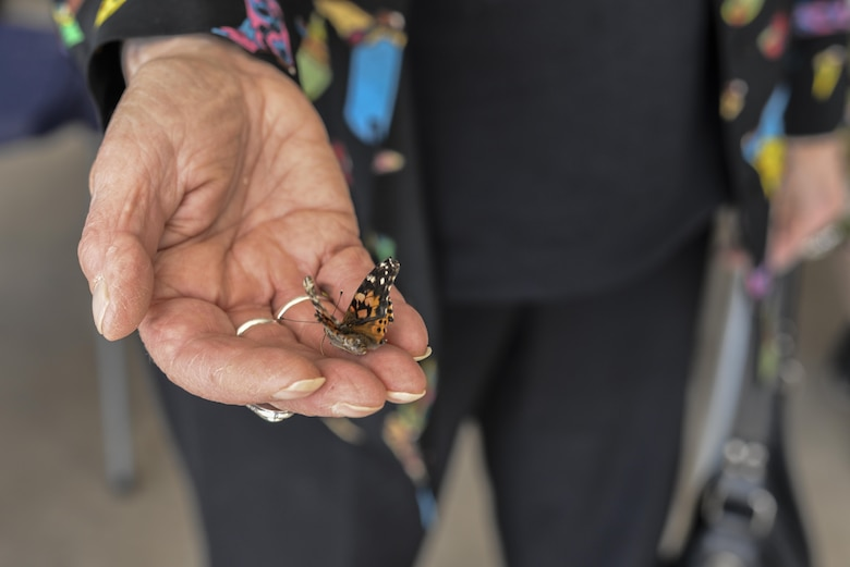 Annique Dveirin, Holocaust survivor, releases a butterfly during a Holocaust remembrance ceremony at Davis-Monthan Air Force Base, Ariz., April 24, 2017. The butterflies were released to signify hope, transformation and freedom. (U.S. Air Force photo by Airman 1st Class Giovanni Sims)