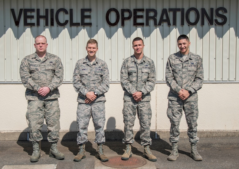 U.S. Air Force Airmen from the 35th Logistics Readiness Squadron pose for a photo at Misawa Air Base, Japan, April 25, 2017. The 35th LRS personnel pictured from left to right, Senior Airman John Proctor, Staff Sgts Scot Boone, Brent Bowes and Kyle Cherry,all vehicle operator dispatchers, and Tech. Sgt. Canaan Hatcher, not pictured, a quality assurance evaluator, rescued a Thai man Febuary 19, 2017 who was stuck upside down in snow at Niseko Mountain, Japan. (U.S. Air Force photo by Senior Airman Brittany A. Chase)
