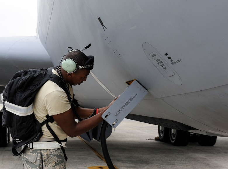 U.S. Air Force Staff Sgt. Jason Cokley, 909th Aircraft Maintenance Unit crew chief, plugs in a power source to a KC-135 Stratotanker assigned to the 909th Air Refueling Squadron April 20, 2017, at Kadena Air Base, Japan. Crew chiefs play a vital role in ensuring aircraft are ready for flight and pre-flight inspections by pilots. (U.S. Air Force photo by Senior Airman Lynette M. Rolen)