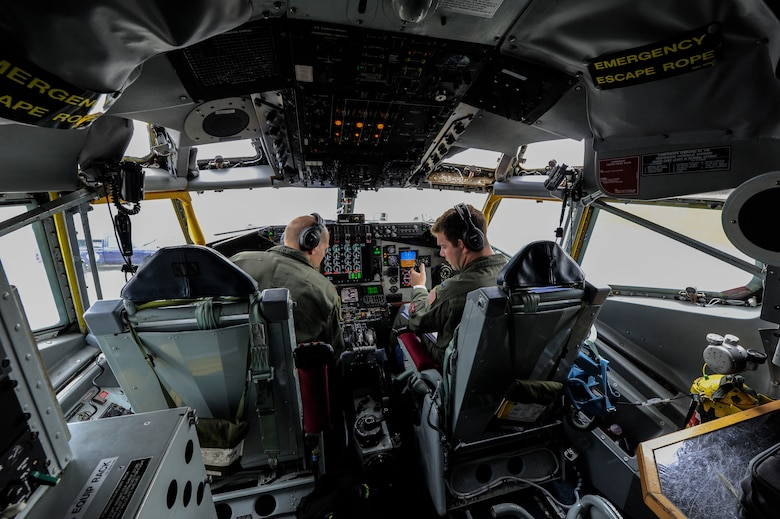 U.S. Air Force Maj. Jacob Johnson, 909th Air Refueling Squadron director of wing inspections and 1st Lt. Huston Harrison, 909th ARS standards and evaluations officer, conduct pre-flight checks aboard a KC-135 Stratotanker April 20, 2017, at Kadena Air Base, Japan. The KC-135 is the primary refueling aircraft for the Air Force, capable of supporting peacetime and contingency operations. (U.S. Air Force photo by Senior Airman Lynette M. Rolen)