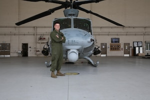 Cpl. Tyler Eddy, an airframes mechanic with Marine Light Attack Helicopter Squadron (HMLA) 169, stands in front of a UH-1Y Huey at Marine Corps Air Station Camp Pendleton, Calif., April 24. In July 2017, Eddy is expected to complete his active-duty enlistment with the Marine Corps and pursue a doctorate in physics at Princeton University in Princeton, N.J. (U.S. Marine Corps photo by Lance Cpl. Jake M.T. McClung/Released)