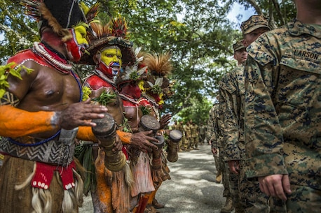 Papua New Guinean folk dancers line up with U.S. Marines and sailors during a banquet as part of a closing ceremony for a military tactics training exchange at Taurama Barracks, Papua New Guinea, April 18, 2017. Marines and sailors assigned to the 11th Marine Expeditionary Unit conducted the training with Papua New Guinea Defense Force service members. Marine Corps photo by Cpl. Devan K. Gowans