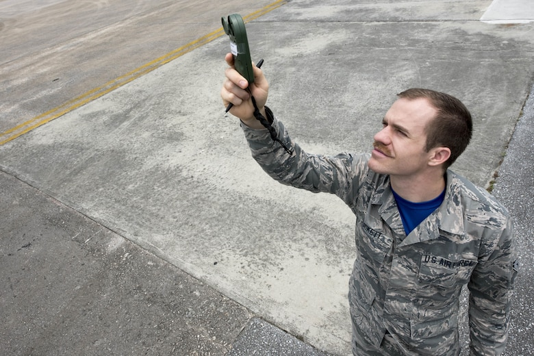 U.S. Air Force Airman 1st Class Joshua Tuckett, 18th Operations Support Squadron weather flight weather apprentice, conducts weather observation using a kestrel reader April 21, 2017, at Kadena Air Base, Japan. The kestrel is used to measure air pressure, relative humidity, wind speed and direction. (U.S. Air Force photo by Senior Airman John Linzmeier)