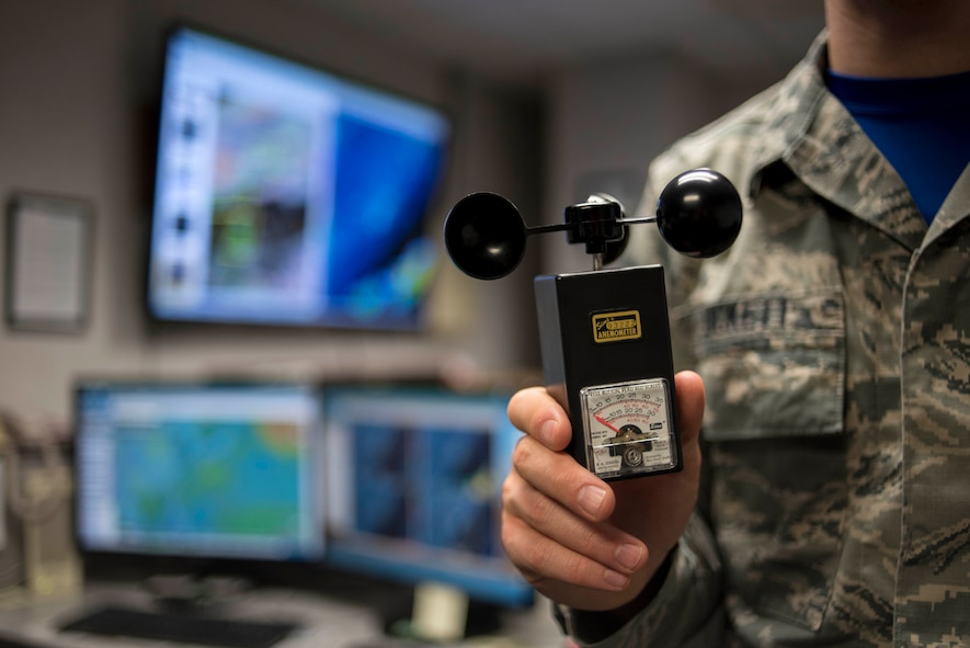 U.S. Air Force Airman 1st Class Joshua Tuckett, 18th Operations Support Squadron weather flight weather apprentice, holds an anemometer April 21, 2017, at Kadena Air Base, Japan. Manual devices such as the anemometer were used to measure wind speeds, but have since been replaced by automated systems that can provide instant data to forecasters. (U.S. Air Force photo by Senior Airman John Linzmeier)