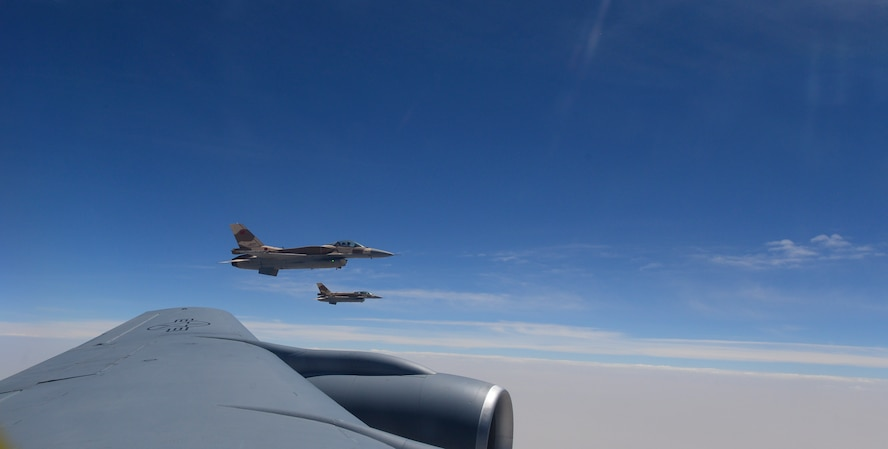 Moroccan F-16 Fighting Falcons fly off the wing of a U.S. Air Force KC-135 Stratotanker assigned to the 100th Air Refueling Wing from RAF Mildenahall, England, over Morocco, during exercise African Lion on April 18, 2017. African Lion is a multinational exercise focused on enhancing professional relationships and strengthening regional security. (U.S. Air Force photo by Staff Sgt. Micaiah Anthony)