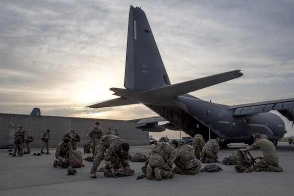 U.S. Air Force Airmen and U.S. Army soldiers prepare for parachute training on an MC-130J Commando II April 24, 2017, at Kadena Air Base, Japan. The training provided an opportunity for the sister services to learn from each other and stay proficient in their combat and life-saving skillsets. (U.S. Air Force photo by Senior Airman John Linzmeier)