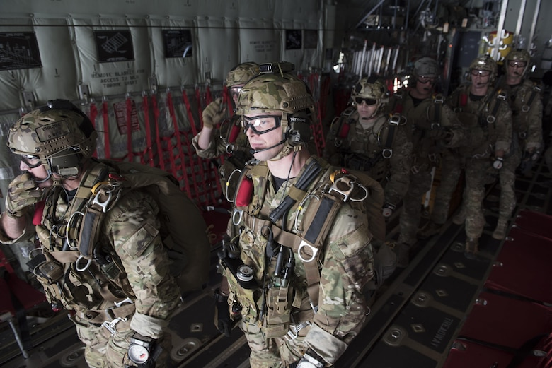 U.S. Air Force Airmen and U.S. Army Soldiers prepare to execute a high altitude, low opening jump off an MC-130J Commando II April 24, 2017, above Okinawa, Japan. Air drop capabilities enable joint forces to provide quick support to those in need. (U.S. Air Force photo by Senior Airman John Linzmeier)