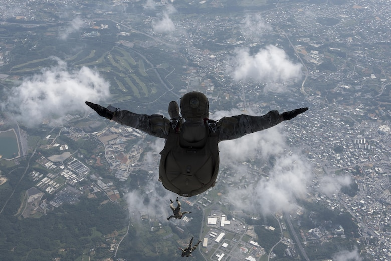 U.S. Air Force Airmen and U.S. Army Soldiers perform a high altitude, low opening jump off an MC-130J Commando II April 24, 2017, above Okinawa, Japan. The HALO jump is a method of delivering personnel, equipment, and supplies from a transport aircraft at a high altitude via free-fall parachute insertion. (U.S. Air Force photo by Senior Airman John Linzmeier)