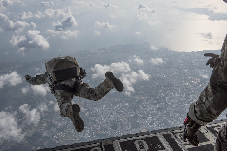 U.S. Air Force Airmen conduct a high altitude, low opening jump off an MC-130J Commando II April 24, 2017, above Okinawa, Japan. (U.S. Air Force photo by Senior Airman John Linzmeier)
