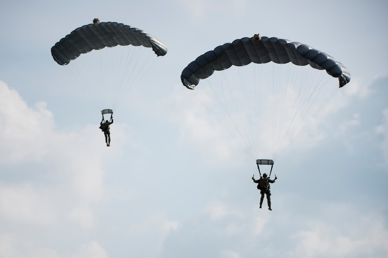 U.S. Air Force Airmen and U.S. Army Soldiers conduct parachute training April 24, 2017, above Kadena Air Base, Japan. Parachute capabilities enable Airmen and Soldiers to perform rescue operations and humanitarian missions in locations where aircraft cannot land. (U.S. Air Force photo by Senior Airman Omari Bernard)