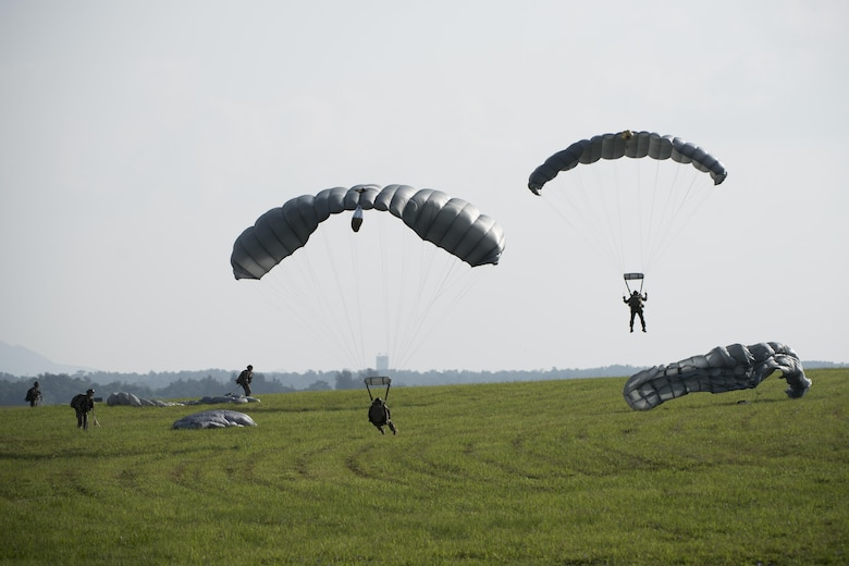U.S. Air Force Airmen and U.S. Army Soldiers conduct parachute training April 24, 2017, above Kadena Air Base, Japan. Parachute training better enables joint and bilateral long-range rescue and rapid response to humanitarian or security crises. (U.S. Air Force photo by Senior Airman Omari Bernard)