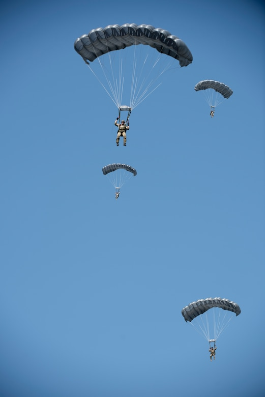 U.S. Air Force Airmen and U.S. Army Soldiers conduct parachute training April 24, 2017, above Kadena Air Base, Japan. Soldiers and Airmen stationed on Okinawa must retain their proficiency in jump operations through constant practice. (U.S. Air Force photo by Senior Airman Omari Bernard)