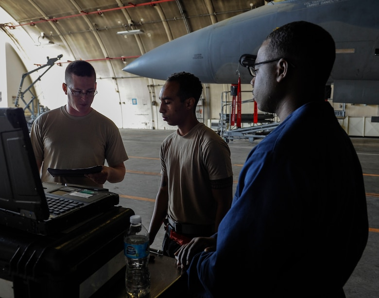U.S. Air Force Tech. Sgt. Timothy Peppler, 372nd Training Squadron, Detachment 15, F-15 Eagle aircraft maintenance instructor, Senior Airman Devon Moore, 67th Aircraft Maintenance Unit crew chief, and Airman 1st Class Tychaun Kingston, 44th AMU crew chief, review training content April 24, 2017, at Kadena Air Base, Japan. The 372nd TRS, Det. 15, provides necessary upgrade training classes for Airmen stationed on Kadena. (U.S. Air Force photo by Senior Airman Lynette M. Rolen)