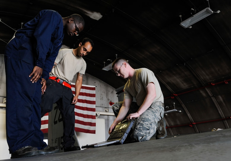 U.S. Air Force Airman 1st Class Tychaun Kingston, 44th Aircraft Maintenance Unit crew chief, Senior Airman Devon Moore, 67th AMU crew chief, and Tech. Sgt. Timothy Peppler, 372nd Training Squadron, Detachment 15, F-15 Eagle aircraft maintenance instructor, prepare to conduct maintenance training April 24, 2017, at Kadena Air Base, Japan. The 372nd TRS, Det. 15, provides upgrade training to more than 90 of Kadena's crew chiefs annually. (U.S. Air Force photo by Senior Airman Lynette M. Rolen)