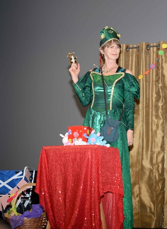 """Queen Emeralda, professional storyteller, leaves her home in Fairyland to bring """"laughter and fun"""" to Marine Corps Logistics Base Albany's young audience, who filled the Base Theater, April 25. The event, which was hosted in celebration of the Month of the Military Child, was also held to bring awareness to and in observance of the 2017 Child Abuse and Neglect Prevention Month. Three-year old students from MCLB Albany's Child Development Center as well as kindergarteners from International Studies Elementary Charter School, Albany, Ga., attended the activities."""