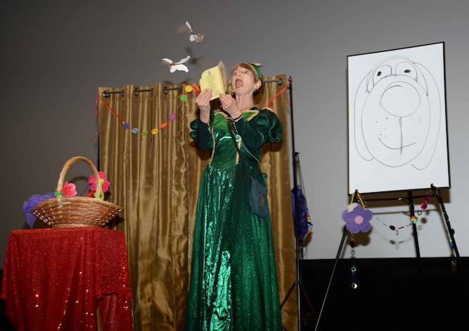 "Queen Emeralda, professional storyteller, leaves her home in Fairyland to bring ""laughter and fun"" to Marine Corps Logistics Base Albany's young audience, who filled the Base Theater, April 25. The event, which was hosted in celebration of the Month of the Military Child, was also held to bring awareness to and in observance of the 2017 Child Abuse and Neglect Prevention Month. Three-year old students from MCLB Albany's Child Development Center as well as kindergarteners from International Studies Elementary Charter School, Albany, Ga., attended the activities."