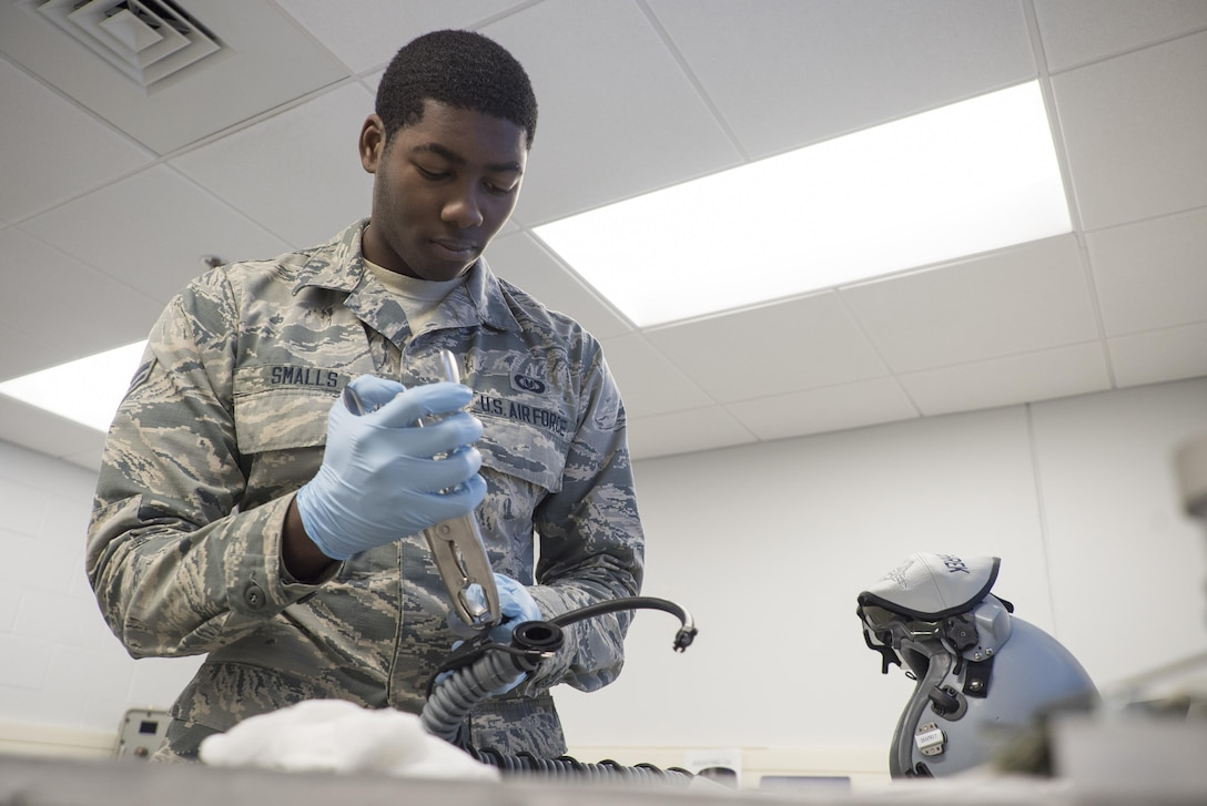 Airman 1st Class Khalil Smalls, 339th Flight Test Squadron aircrew flight equipment helper, reassembles components of an MBU-20/P oxygen mask April 26, 2017, at Robins Air Force Base, Georgia. The mask provides pressure breathing for aircrew and reduces the probability of G-induced loss of consciousness. (U.S. Air Force photo by Jamal D. Sutter)