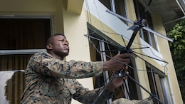 U.S. Marine Staff Sgt. Alexander Davis adjusts a satellite communication antenna during Balikatan 2017 at Camp Lapulapu, Cebu, April 25, 2017. Balikatan is an annual U.S.-Philippine military bilateral exercise focused on a variety of missions, including humanitarian assistance and disaster relief, and counterterrorism. (U.S. Air Force photo by Senior Airman Corey Pettis)