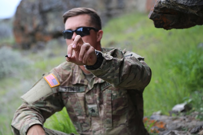 Army Sgt. Brandon Stubbs holds a beetle during a survival, evasion, resistance, and escape class at the Yakima Training Center, Yakima, Wash., April 25, 2017. Army photo by Sgt. Kalie Jones