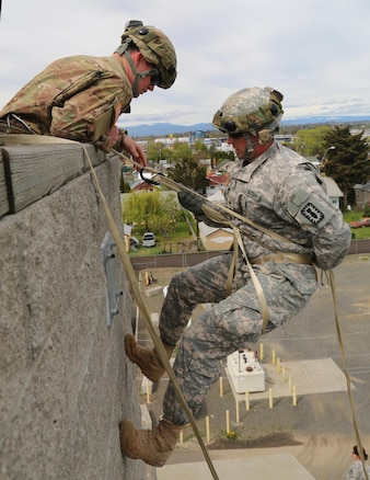 Army Sgt. Anthony Barba lowers during a vertical access training exercise at Yakima Fire Station 95, Yakima, Wash., April 25, 2017. Army photo by Sgt. Kalie Jones