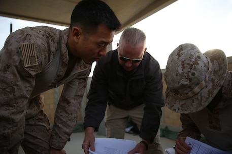 U.S. Marine Maj. Yongjin Chang, the officer in charge of 4th Air Naval Gunfire Liaison Company, Special Purpose Marine Air-Ground Task Force-Crisis Response-Central Command,  discusses range boundaries and target sets during a  close air support exercise while forward deployed to the Middle East, Dec. 14, 2016. 4th ANGLICO, M Detachment, an all Reserve unit based out of West Palm Beach, Florida, is currently forward deployed in the Middle East with Special Purpose Marine Air-Ground Task Force-Crisis Response-Central Command. M Detachment is comprised of forward observers, radio operators, joint fires observers, artillery officers and a corpsman, all of which play an important role in the SPMAGTF's crisis response mission.   (U.S. Marine Corps photo by Cpl. Shellie Hall)