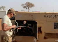 Senior Airman Hayden Hellems, 768th Expeditionary Air Base Squadron Power Production journeyman, pressure-washes a generator at Nigerien Air Base 101, Niger, April 1, 2017. Periodic maintenance on the generators helps to cut down on wear and tear, and keeps them operating efficiently. (U.S. Air Force photo by Senior Airman Jimmie D. Pike)