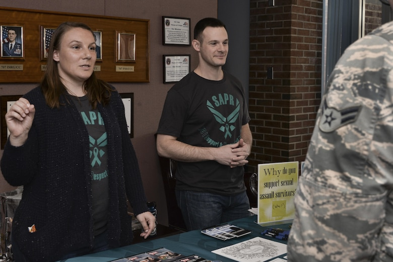 Staff Sgt. Melissa and Capt. Robert, 7th Intelligence Squadron volunteer victim advocates, talk to 70th Intelligence, Surveillance and Reconnaissance Wing Airmen about the Stick with Survivors project April 13. Stick with Survivors is a project created by the 70th ISRW Sexual Assault Prevention and Response office that will assist military and civilian members in showing their support for sexual assault survivors. (U.S. Air Force photo by Staff Sgt. Alexandre Montes)