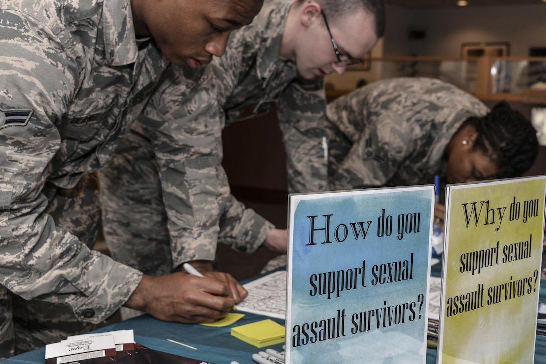 Airmen from the 70th Intelligence, Surveillance and Reconnaissance Wing write messages to sexual assault survivors on sticky notes as part of the Stick with Survivors project April 13. Stick with Survivors is a project created by the 70th ISRW Sexual Assault Prevention and Response office that will assist military and civilian members in showing their support for sexual assault survivors. (U.S. Air Force photo by Staff Sgt. Alexandre Montes)