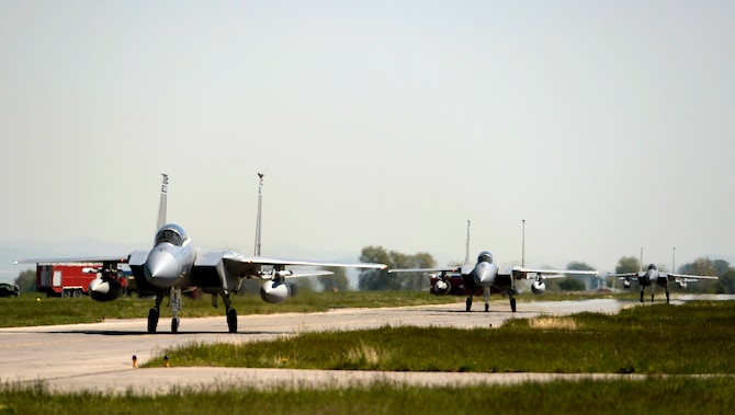 Twelve F-15C Eagles from the 122nd Expeditionary Fighter Squadron arrived at Graf Ignatievo Air Base, Bulgaria, April 26. Along with the aircraft, approximately 300 Airmen from the Louisiana and Florida Air National Guard are deployed to Europe as part of a Theater Security Package in support of Operation Atlantic Resolve with the goal of strengthening interoperability and enhancing regional security. (U.S. Air Force photo by Tech. Sgt. Staci Miller)