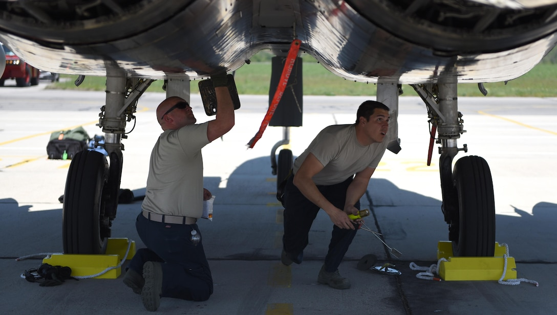 Airmen from the 122nd Expeditionary Fighter Squadron perform maintenance at Graf Ignatievo Air Base, Bulgaria, April 26, 2017. F-15Cs from the Louisiana and Florida Air National Guard are deployed to Europe to participate in a Theater Security Package. These F-15s will conduct training alongside NATO allies to strengthen interoperability and to demonstrate U.S. commitment to the security and stability of Europe. (U.S. Air Force photo by Tech. Sgt. Staci Miller)