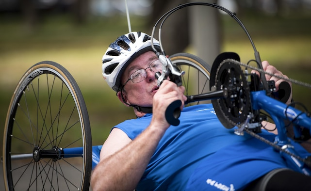 Chris Rust, a Warrior Games athlete, prepares to take a turn on a recumbent bike during a cycling session at the Air Force team's training camp at Eglin Air Force Base, Fla., April 26. The base-hosted, week-long Warrior Games training camp is the last team practice session before the yearly competition in June. (U.S. Air Force photo/Samuel King Jr.)