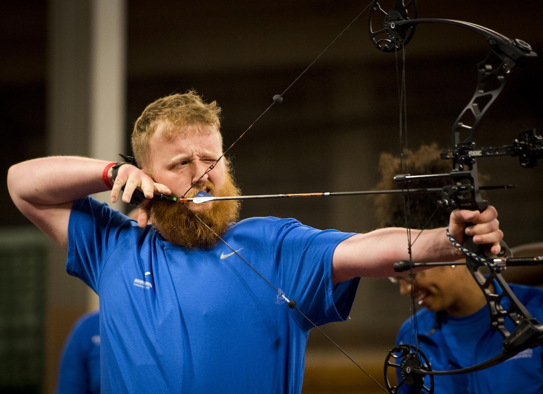 Robert Wiles, a Warrior CARE athlete, aims for a bullseye during an archery session at the adaptive sports camp at Eglin Air Force Base, Fla., April 24. The base hosts the week-long Wound Warrior CARE event that helps recovering wounded, ill and injured military members through specific hand-on rehabilitative training. (U.S. Air Force photo/Samuel King Jr.)