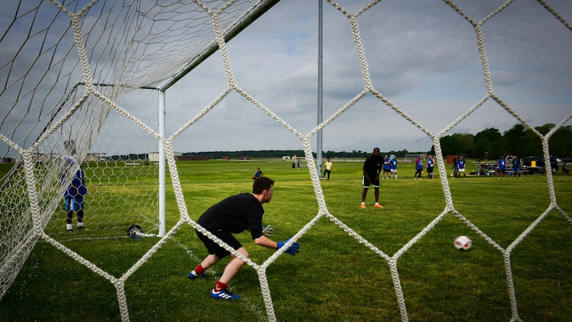 A Royal air force Airman prepares to block a soccer ball, during the ATLANTIC TRIDENT 17 soccer tournament, at Joint Base Langley-Eustis, Va., April 22, 2017. The U.S. Air Force, RAF and French air force Airmen, who participated during the exercise, were given the opportunity to socialize with each other while putting their athleticism on display during the tournament. (U.S. Air Force photo/Staff Sgt. Areca T. Bell)