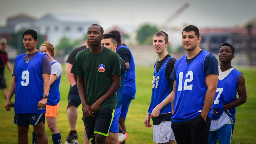 U.S. Air Force Airmen cheer on their team mates during a soccer match against the French air force during the ATLANTIC TRIDENT 17 soccer tournament, at Joint Base Langley-Eustis, Va., April 22, 2017. The Airmen, who participated during the exercise, were given the opportunity to improve their teamwork during exercise operations by participating in social events off the flightline. (U.S. Air Force photo/Staff Sgt. Areca T. Bell)