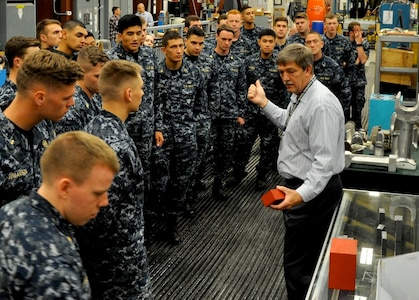 DAHLGREN, Va. (April 14, 2017) - Naval Surface Warfare Center Dahlgren Division (NSWCDD) Electromagnetic Railgun Lead Systems Engineer Chester Petry explains railgun components and technology to U.S. Naval Academy Midshipmen. Since 2008, Midshipmen have taken an annual field trip to NSWCDD to see new and emerging technologies they may work with at some point in their future careers as commissioned officers.