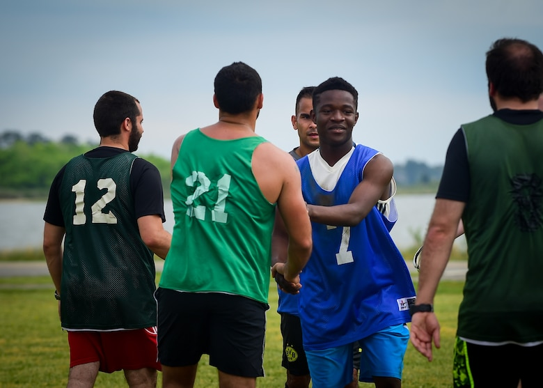 U.S. Air Force and French air force Airmen shake hands at the end of the ATLANTIC TRIDENT 17 soccer tournament, at Joint Base Langley-Eustis, Va., April 22, 2017. The Airmen were given the opportunity to socialize with each other while putting their athleticism on display during the tournament. (U.S. Air Force photo/Staff Sgt. Areca T. Bell)