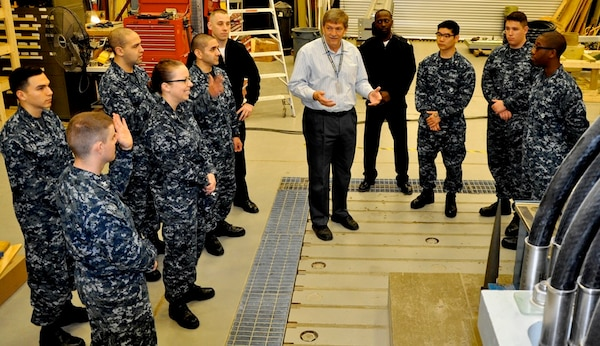 DAHLGREN, Va. (April 14, 2017) - Navy Electromagnetic Railgun Lead Systems Engineer Chester Petry explains railgun components and technology to Sailors from Aegis Training and Readiness Center (ATRC). The Sailors are taking ATRC courses that provide them with the knowledge, ability, and skill to operate and maintain the Aegis Combat System.
