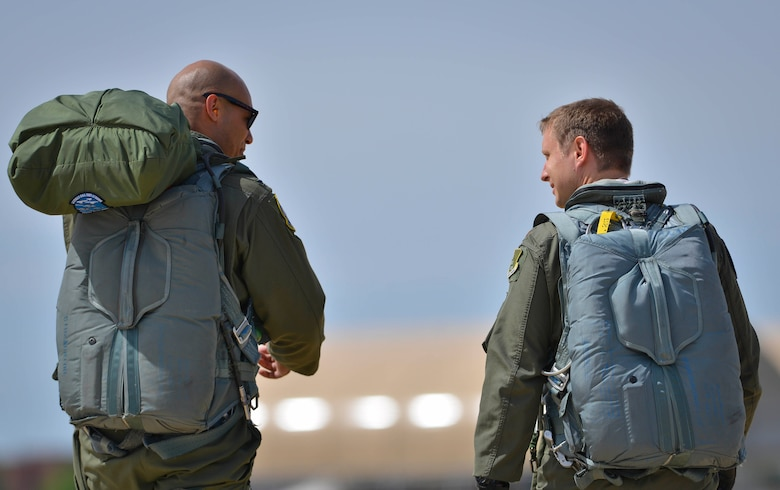 (From left) U.S. Air Force 1st Lt. Edward Galloway and Maj. Nathaniel Lightfoot, 71st Fighter Training Squadron aggressor pilots, return from an air combat training mission during ATLANTICTRIDENT 17 at Joint Base Langley-Eustis, Va., April 18, 2016. This exercise was designed to encourage the sharing and development of air combat practices with both the French and Royal air force against a range of potential threats. (U.S. Air Force photo/Staff Sgt. Natasha Stannard)