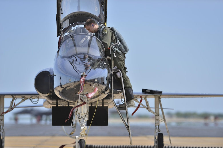 U.S. Air Force Maj. Nathaniel Lightfoot, 71st Fighter Training Squadron aggressor pilot, deplanes after a combat training mission during ATLANTICTRIDENT 17 at Joint Base Langley-Eustis, Va., April 18, 2016. The aggressors are the aerial adversaries of the exercise, which focuses on harnessing fifth-generation capabilities with fourth generation fighters from partnering nations. (U.S. Air Force photo/Staff Sgt. Natasha Stannard)