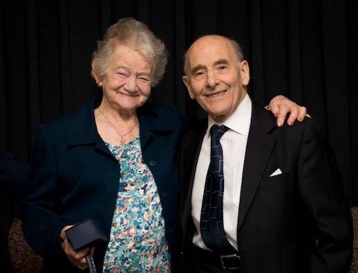 Bob and Ann Kirk, Holocaust survivors and honored guests at the 86th Airlift Wing's Holocaust Remembrance, pose for a photo at Ramstein Air Base, Germany, April 25, 2017. As Jewish people living in Germany before World War II, the Kirks suffered from persecution and escaped to Great Britain via the Kindertranport. Today they travel and share their stories to raise awareness of the Holocaust and honor those who were persecuted. (U.S. Air Force photo by Senior Airman Elizabeth Baker)