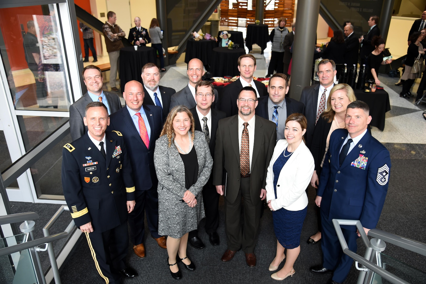 U.S. Army Maj. Gen. Daniel Karbler (front, left), U.S. Strategic Command (USSTRATCOM) chief of staff; U.S. Air Force Chief Master Sgt. Patrick F. McMahon (front, right), USSTRATCOM senior enlisted leader; Dr. Douglas Derrick (second row, 2nd from right), University of Nebraska at Omaha (UNO) fellowship co-director; and Dr. Gina Ligon (second row, right), UNO fellowship co-director, recognize graduates of the Strategic Leadership Fellows Program at UNO's Peter Kiewit Institute, April 21, 2017. The National Strategic Research Institute, UNO and USSTRATCOM launched the inaugural fellows program in 2014. Each year, 10 USSTRATCOM employees are hand-selected as Strategic Leadership Fellows for the spring academic semester. Fellows are charged with scholarly research and writing aimed at addressing the nation's most urgent challenges.