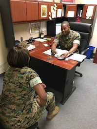 Sgt. Matthew M. JohnsonGrant of Headquarters Company, Marine Corps Communication-Electronics School conducts an interview with a Careerist. JohnsonGrant's primary duties are as the Career Planner for Marine Corps Communication-Electronics School.