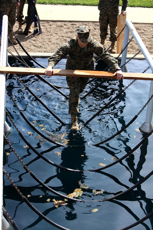 A Marine Corps officer candidate navigates an obstacle while participating in an obstacle course aboard Camp Dodge, Johnston, Iowa, April 22, 2017. The Officer Candidate School (OCS) preparation weekend was held to enhance readiness through challenging and realistic training with a focus on basic Marine Corps knowledge and skills. (U.S. Marine Corps photo by Cpl. Zachery B. Martin)