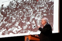 Dr. Roger M. Loria, Virginia Commonwealth University School of Medicine professor, speaks during the Holocaust Remembrance Ceremony at Joint Base Langley-Eustis, Va., April 21, 2017. Loria, a Holocaust survivor, was the guest speaker at the event, which was hosted by the 7th Transportation Brigade. Loria's key message was that although his life began during the Holocaust, it has not been defined by it. (U.S. Army photo/Spc. Wilmarys Roman Rivera)