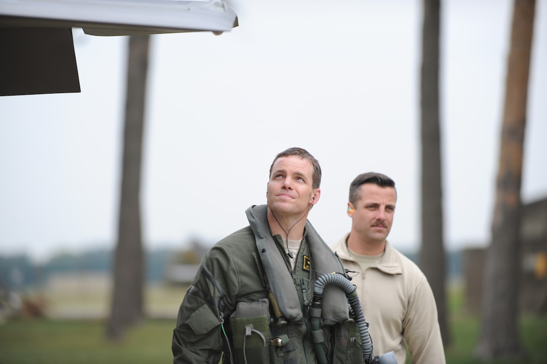 Maj. Jayson Rickard, F-35 pilot in the 419th Fighter Wing, and Tech. Sgt. Ryan Johnston, 419th crew chief, conduct a preflight check while deployed to Europe. Eight F-35A Lightning IIs and about 250 personnel from the Air Force Reserve 419th FW and active duty 388th FW at Hill Air Force Base, Utah, are in Europe for several weeks and will travel to multiple NATO bases in an effort to maximize training opportunities and demonstrate U.S. support to NATO. In their civilian lives, Rickard is a pilot for Delta Air Lines and Johnston works for SkyWest Airlines. Both reservists are currently on full-time orders to help fortify F-35A operations at Hill AFB. (U.S. Air Force photo/Micah Garbarino)