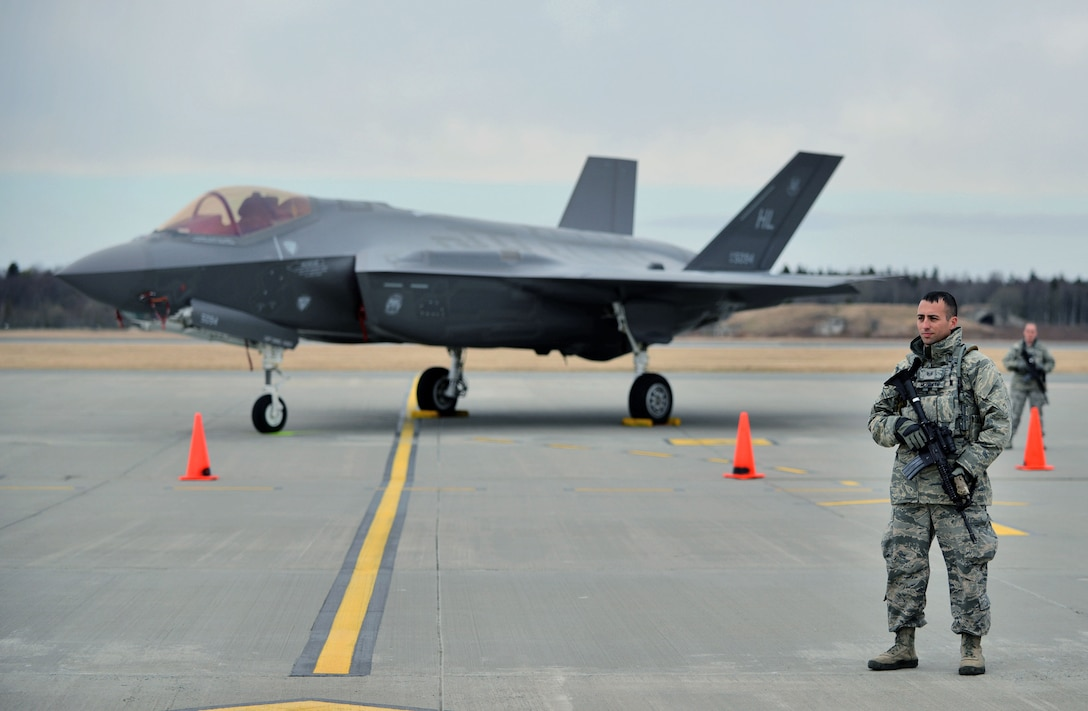 Staff Sgt. Joseph McGrath, 419th Security Forces Squadron, stands beside an F-35A Lightning II at Amari Air Base, Estonia. SFS personnel provided security this week for the aircraft's arrival in the country, which is one of several stops for the F-35 during its first European deployment. Eight jets and about 250 personnel from the Air Force Reserve 419th Fighter Wing and active duty 388th FW at Hill Air Force Base, Utah, are in Europe for several weeks and will travel to multiple NATO bases in an effort to maximize training opportunities and demonstrate U.S. support to NATO. (U.S. Air Force photo/Micah Garbarino)