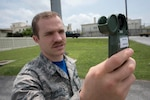 Air Force Airman 1st Class Joshua Tuckett, a weather apprentice with the 18th Operations Support Squadron weather flight, collects weather data using a kestrel reader at Kadena Air Base, Japan, April 21, 2017. The device measures air pressure, relative humidity, wind speed and direction. Air Force photo by Senior Airman John Linzmeier