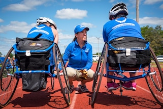 Warrior Games coach Teresa Skinner talks with athletes at track and field practice during the Air Force team's Warrior Games training camp at Eglin Air Force Base, Fla., April 26, 2017. The weeklong camp is the last team practice session before the yearly competition in June. Air Force photo by Samuel King Jr.
